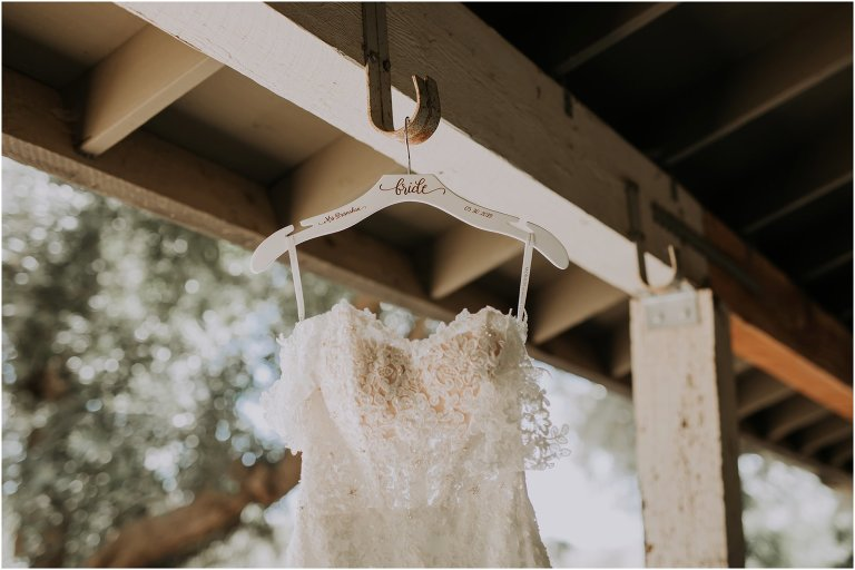 image of hanging wedding dress from Galway downs bridal suite, Temecula wedding photographer