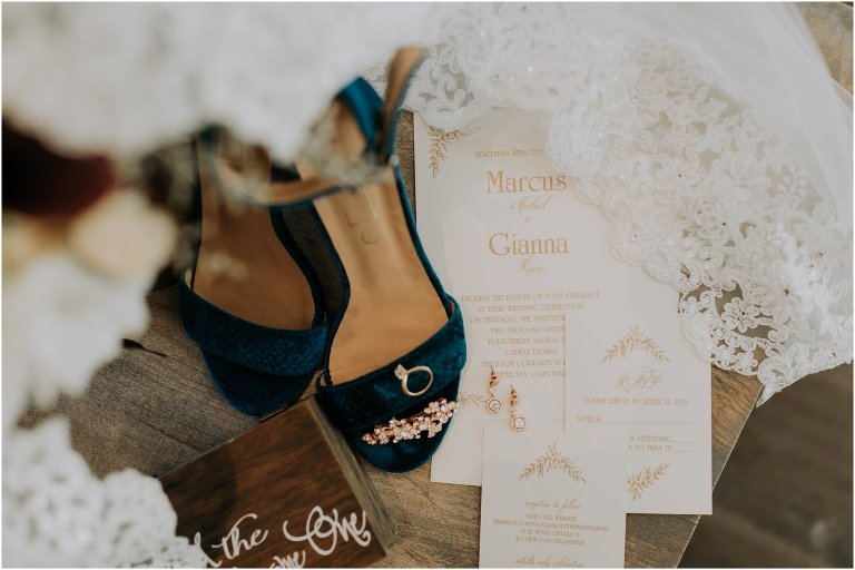wedding details, wedding invitation, shoes, rings, veil and flowers